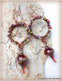 earrings of artisan lampwork, forged copper, tiny wire-wrapped glass beads.  B Two Trees Studio,