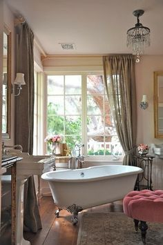 Love the tub and the burlap curtains!