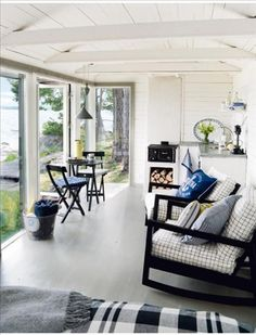 fromscandinaviawithlove: Summer house in Sweden. Photo by Pernilla Hed. black and white cottage Small Space Living, Living Spaces, Living Room, Sweden House, Floor To Ceiling Windows, Big Windows, House Windows, Ceiling Fans, Cabins And Cottages