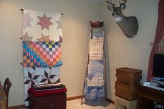 My vintage quilts displayed on curtain rods, to display loved things is the best!