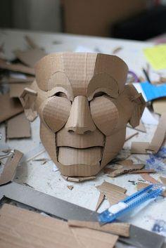 Cardboard mask for papier mache Cardboard Mask, Cardboard Sculpture, Cardboard Crafts, Paper Crafts, Painting Cardboard, Cardboard Spaceship, Cardboard Costume, Cardboard Design, Paper Sculptures