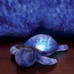 The Seascape Projecting Turtle - This is the plush turtle that projects a soothing pattern of undulating water onto a room's walls and ceiling to create a tranquil sleeping environment for children.