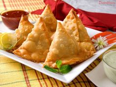 Lahori Samosa. Every tea time includes Samosa and Garam Chai. It is believed that Samosa was first introduced at Lahore railway station and spread to all the corners of India along every train stop. Every railway station had the hawkers selling Samosa and Garam Chai. It is no wonder that the Samosa with traditional stuffing is also called Lahori Samosa. Ingredients For Dough: 500 gm maida (refined flour) 1/2 cup ghee or oil 5 gm ajwain Salt Water Oil for deep frying the samosas ...