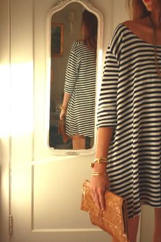 comfy black and white striped shirt dress with camel clutch. #street style