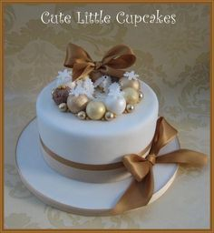 Not a traditional fruit cake, but instead a Chocolate & Orange cake. Had a free-hand in the design but sat looking a blank white cake for a while! But after rooting through my ribbon drawer, took inspiration from some gorgeous gold ribbon. Mini Christmas Cakes, Christmas Themed Cake, Christmas Cake Designs, Christmas Cake Decorations, Christmas Sweets, Holiday Cakes, Christmas Cooking, Gold Christmas, Xmas Cakes