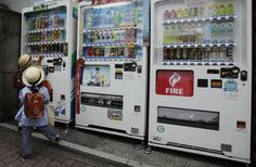 A kindergartner buys a drink from a vending machine in Tokyo, June 25, 2012. (Shizuo Kambayashi/Associated Press) #