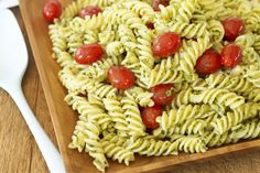 Mix cherry tomatoes and spiral pasta with parmesan, basil leaves and olive oil to create a savoury pasta meal.