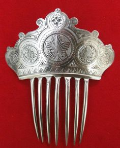 Victorian Sterling Silver Hair Comb Circa 1885, American. Gorgeous, but it reminds me of the poisoned comb that puts Snow White into a coma.
