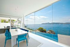 Modern White Interior Design In Outstanding Mallorcan Villa White Interior Design, Interior Decorating, White Dining Table, White Ceiling, Floor To Ceiling Windows, Waterfront Homes, Dining Room Design, Dining Area, Dining Chairs