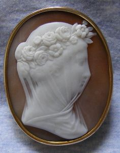 The veiled bride cameo brooch, circa 1860. Amazing how the carver made the veil to look like fabric. Wow!