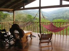 I have fallen head over heels in love with this porch and this view. ohh...how many books could be read in those hammocks!