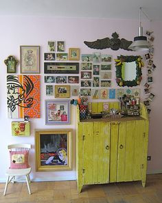 wall collage-love the craziness of it all and the chartreuse piece of furniture--fave!