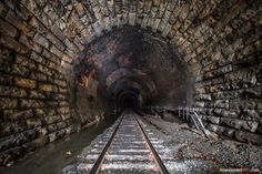 Haunted Hoosac Mountains tunnel in North Adams, MA. Turn off an unnamed dirt road, park at the train tracks, take a short hike, and you'll come f. Abandoned Asylums, Abandoned Places, Abandoned Houses, Ross Island, Most Haunted Places, Nyc Subway, Subway Art, Ghost Hunting, Green Landscape