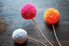 wool pom flowers. $12.00, via Etsy.
