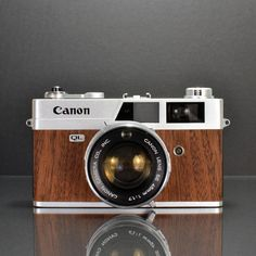 Canonet QL17 Mahogany by Ilott Vintage. They take old cameras and upgrade them. Lovely.