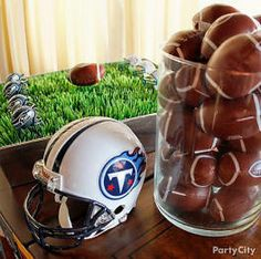 I like the vase with mini footballs...we could reuse those and the big vases...