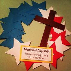 Mini-wreaths for Memorial Day lesson. Paper plate back, card stock stars, cross, and label