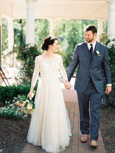 Long sleeve lace wedding dress and a three piece suit for a budget friendly classic wedding day!
