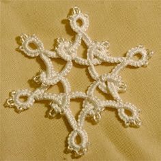 needle tatted snowflake with beads