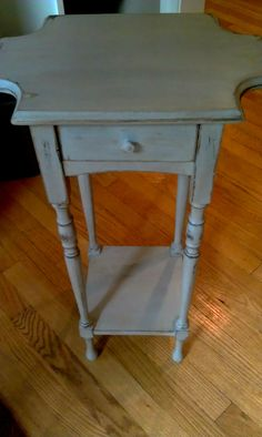 An old smoking stand that has been sitting in my basement for years.  I just love this little piece.  Annie Sloan Paris Grey.  Love it!