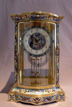 Antique French four glass mantel clock with champleve enamel decoration. at Gavin Douglas Fine Antiques Ltd. in London, specialists in antique clocks and decorative gilt bronze Unusual Clocks, Cool Clocks, Antique Mantel Clocks, Antique Decor, Big Ben Clock, Large Clock, Tick Tock Clock, Raindrops And Roses, Classic Clocks