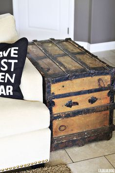 An old steamer trunk used as side table