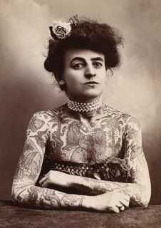 "Maud Stevens Wagner, tattooed by her her husband Gus Wagner. According to tattoo historian Alan Govenar, ""Their relationship developed quickly. She agreed to go with him on the condition that he tattoo her all over and teach her to tattoo""."