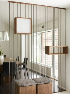 Room divider with shelving and seating