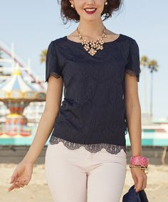 Turn up style with a romantic and versatile top. This surefire wardrobe winner features lace craftsmanship and a fitted silhouette that flatters the figure whether tucked into a pencil skirt or worn over that favorite pair of skinnies.