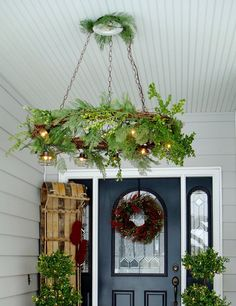 grapevine wreath chandelier | diy christmas decor | christmas front porch | urbancottageliving.com