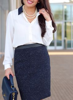 Work outfit: Navy faux leather waist tweed skirt, colorblock collar blouse, navy purse, two row pearl necklace,