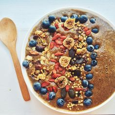 Cacao and Spinach, topped with blueberries, homemade granola and goji berries, wild figs and activated Buckinis