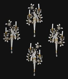 A set of four gilt-metal and cut glass two-light appliques, in the manner of Maison Bagues 20th century
