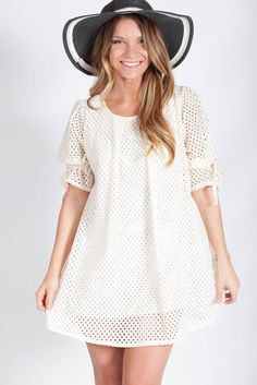 Babydoll Dress - Lotus Boutique    50% Cotton 50% Polyester    baby doll, bow, cute, dress, easter, shift, spring.