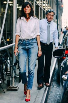 Photo via: Vogue France Emmanuelle Alt masters the classic white shirt and denim mix yet again, but this time with red kitten heels. In fact, Emmanuelle is an endless source of street style inspiratio