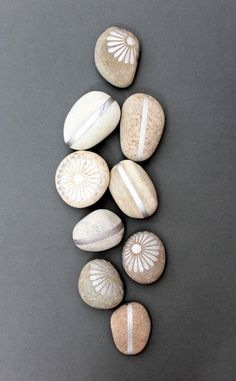 DIY Painted Rocks - silver paint. The littles would love painting with silver (or gold) paint.