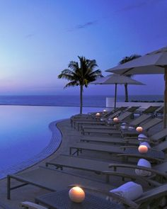 A dedicated pool concierge oversees two peaceful infinity pools with swim-up bars. #Cancun, Mexico