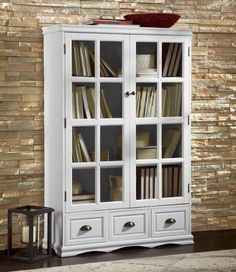 Saunders Cabinet from Midnight Velvet. Framed glass doors display and protect books or keepsakes on 2 adjustable shelves and 1 fixed shelf inside.