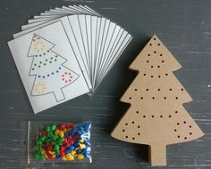 DESCRIPTION:Fine motor game related to spatial orientation. The children arrange the colored pearls on the Christmas tree. This can also be done on the basis of assignment cards. Montessori Activities, Craft Activities, Games Related To Maths, Xmas Crafts, Wood Crafts, Birthday Party Decorations, Christmas Tree Decorations, Christmas Worksheets Kindergarten, Busy Boxes