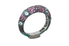 Iris Bangle from The Manhattan Collection: hand made 925 sterling silver plated with black rhodium, hand-set with multi-colored sapphires and black spinel accented by glittering aqua enamel.