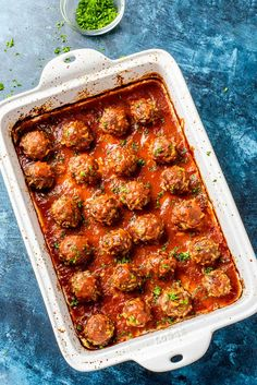 Porcupine Meatballs! A typical meatball with a fun twist, these classic porcupine meatballs are laced with tender white rice and cooked on a bed of easy homemade red sauce. | HomemadeHooplah.com