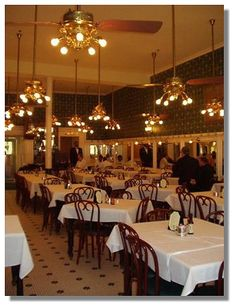Galatoire's on Bourbon Street is the grande dame of Old New Orleans restaurants.  This is a Friday lunch tradition that won't disappoint!