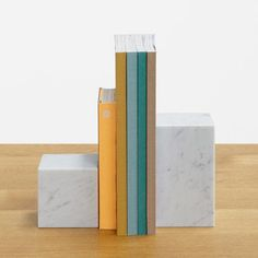 E15 wood and marble home accessory collection | bookends | blocks of white Carrara or black Marquina marble