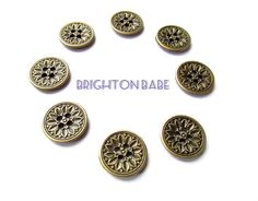 Brass metal buttons stunning. Sunflower relief motif metal buttons. Steam punk, victorian style buttons. Qty: 8 pcs This exceptional antiqued brass buttons were made with meticulous craftmanship and attention to detail. 20 mm in diameter. Metal: Zinc Alloy  They also come in a slightly smaller size 15mm listed separately in this shop in the supplies section https://www.etsy.com/listing/250385805/10-victorian-style-brass-sewing-buttons