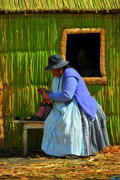 Bolivian lady on the Floating Islands of Titicaca