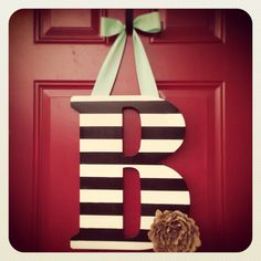 Custom Wood Letter Wreath by CreationsbyJac on Etsy, $44.99 - I could totally make this.