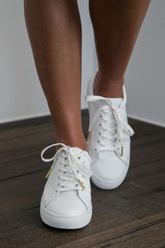 Crafted from super-soft leather and with a rubber sole, these white leather sneakers feature a delicate gold mandala on the back of the heel. Bridal Shoes, Wedding Shoes, Dream Wedding, Bride Sneakers, Indie Wedding Dress, Wedding Dresses, Lace Bride, Grace Loves Lace, Bridesmaids And Groomsmen