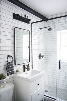 A dramatic before and after transformation in this heritage home. Check out this black and white bathroom that marries modern and traditional!