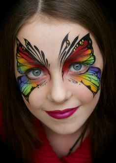 Pixie's Face Painting & Portraits - Rainbow tribal butterfly!