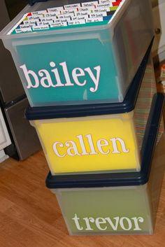 Filing boxes and folders to organize kids' art, memorabilia, etc. Awesome idea!